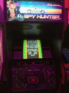 Spy Hunter's cabinet features a unique steering wheel.