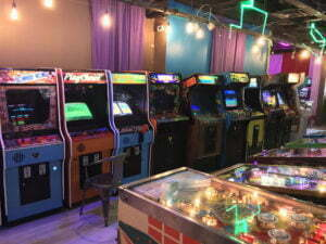 The largest room features arcade machines down one wall.