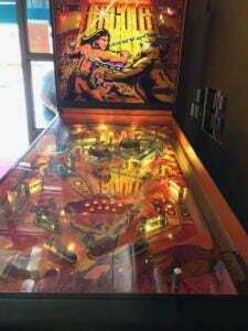 Atari's Hercules pinball machine with lip balm for scale.